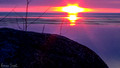 Sunrise glows on Lake Dauphin Manitoba Canada